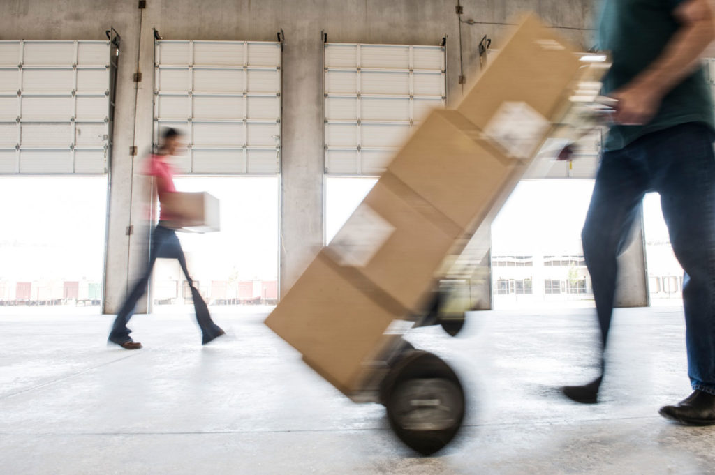 boxes being moved into a new empty warehouse SYTGJCJ
